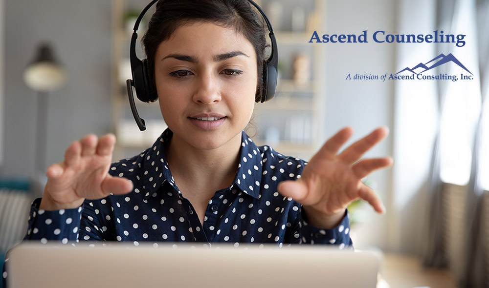 young woman wearing wireless headset during telemedicine call